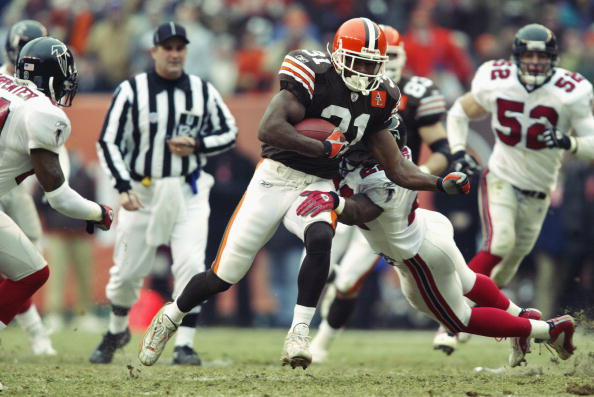 Running back William Green #31 of the Cleveland Browns carries the ball against the Atlanta Falcons during the NFL game at Cleveland Browns Stadium on December 29, 2002 in Cleveland, Ohio.  The Browns defeated the Falcons 24-16.  (Photo by Andy Lyons/Getty Images)